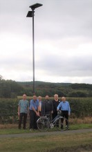 Minsterley and Pontesbury Councillors, Clerk and Highline with one of the new solar lights installed on the cycleway linking the two villages